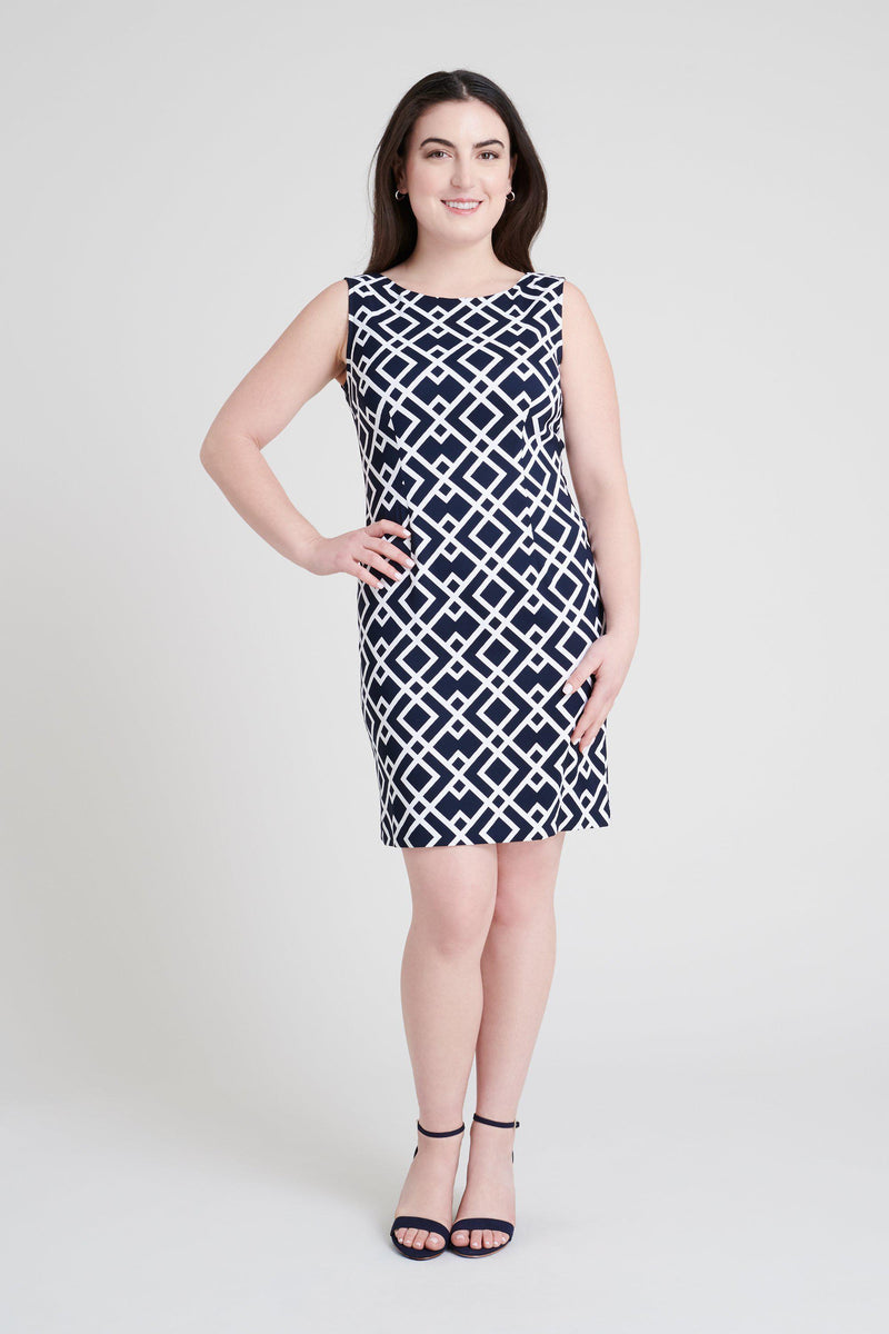 woman-wearing-connected-apparel-Sue Navy Geometric Print Dress [PRE-ORDER]-posing-on-plain-background
