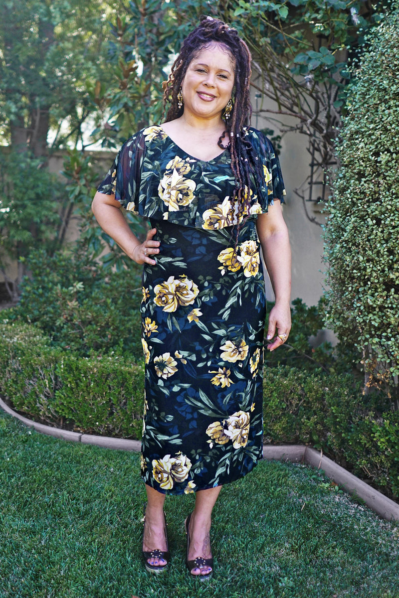 Woman posing wearing Black Sunny Gold Floral Mixi Dress from Connected Apparel