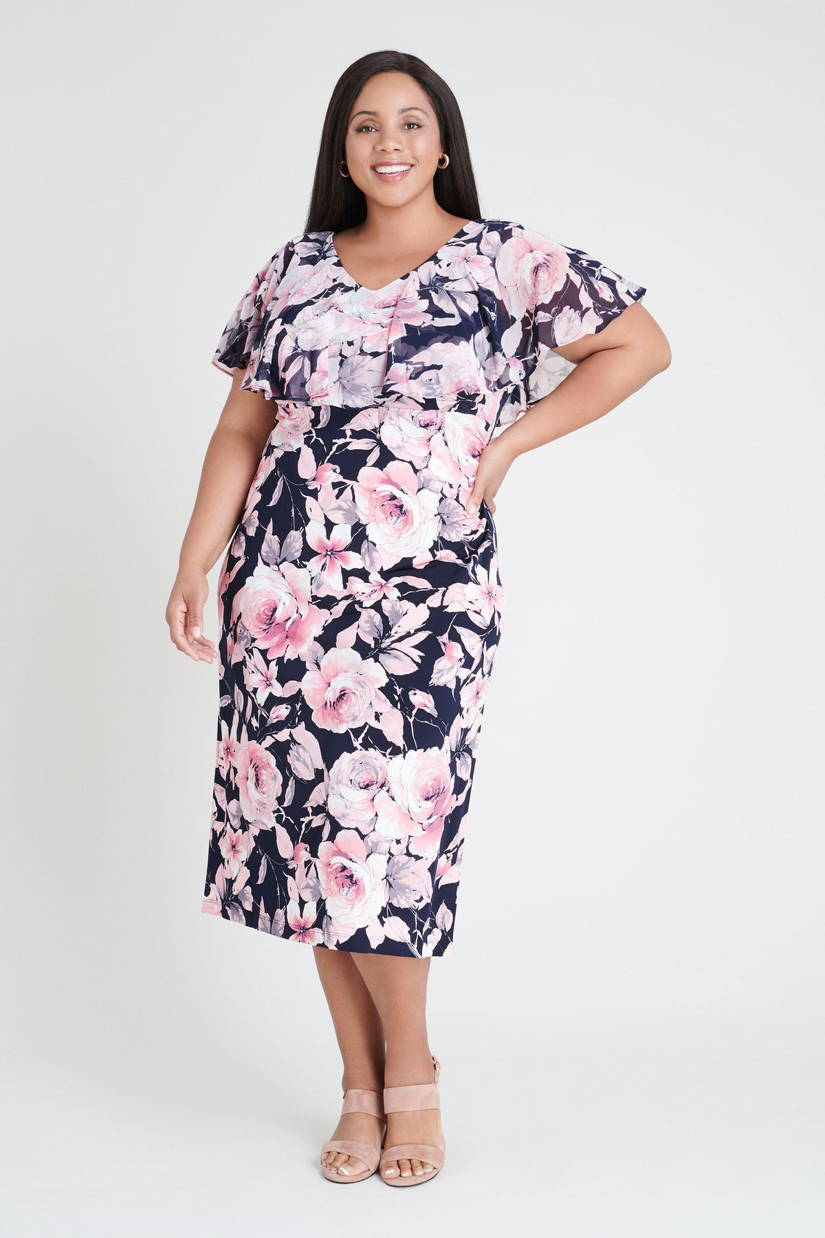Woman posing wearing Navy/Mauve Sunny Navy & Mauve Floral Print Mixi Dress from Connected Apparel
