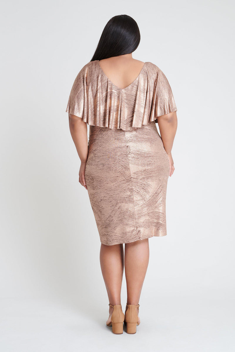 Woman posing wearing Rose Gold Sunny Rose Gold Foil Printed Dress from Connected Apparel