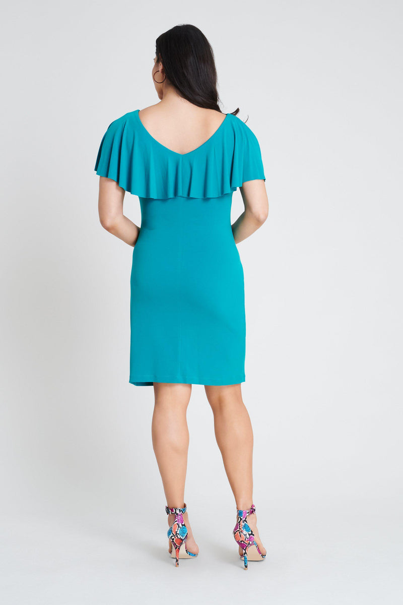Woman posing wearing Seafoam Sunny Seafoam Dress from Connected Apparel