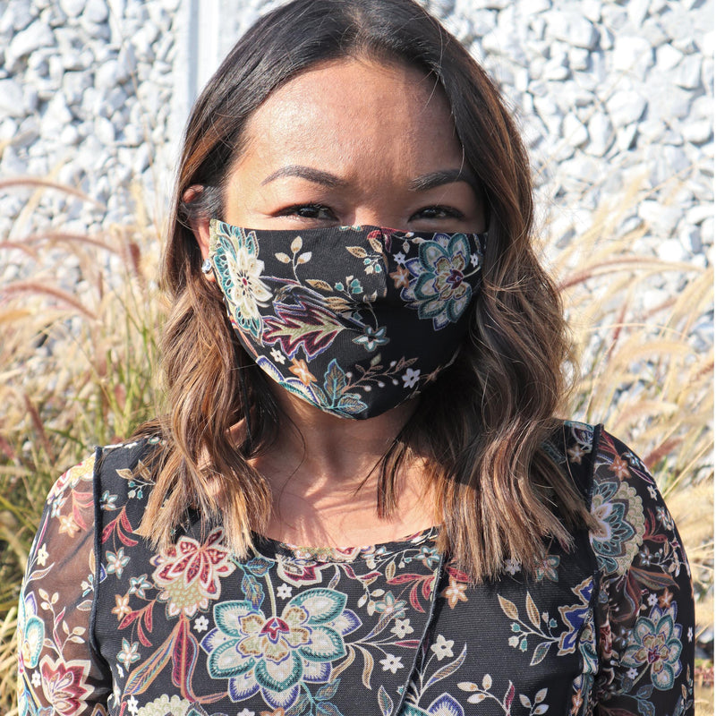 Woman posing wearing Teal Teal Floral Mesh Face Mask from Connected Apparel