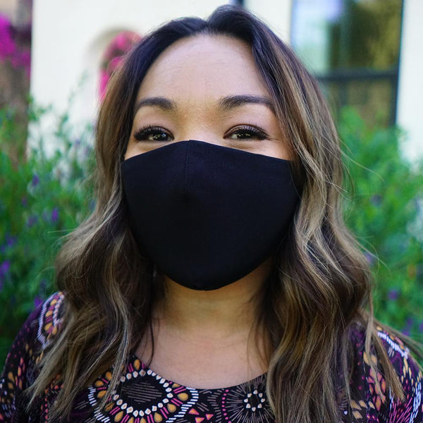 Woman posing wearing BLACK Black Face Mask (3-Pack) from Connected Apparel
