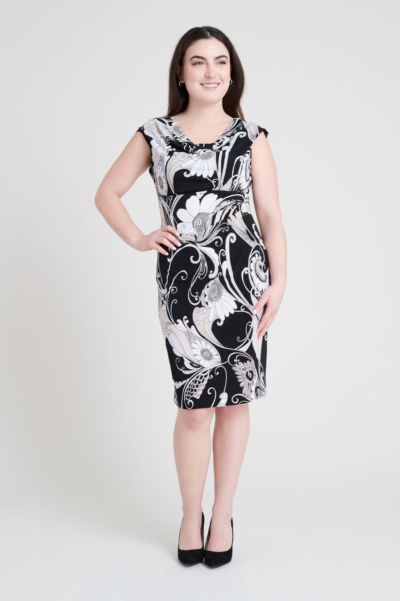 woman-wearing-connected-apparel-Tina Black Paisley Dress [PRE-ORDER]-posing-on-plain-background