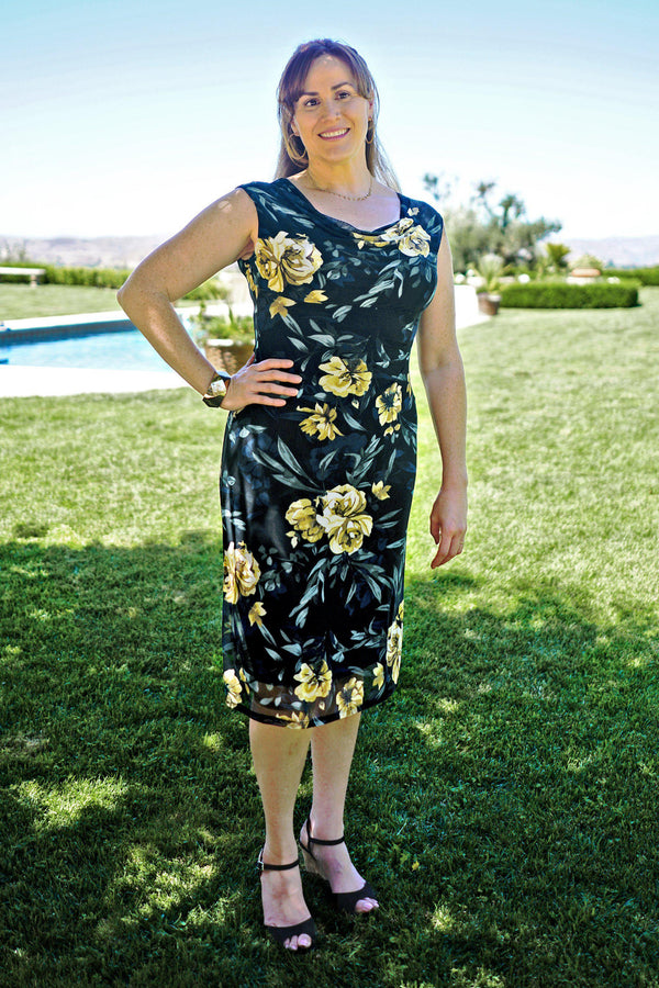 Woman posing wearing Black Tina Floral Sleeveless Midi Dress from Connected Apparel