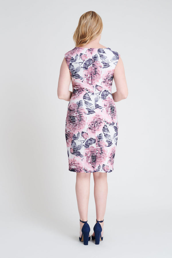 Woman posing wearing Navy/Mauve Tina Navy & Mauve Floral Print Dress from Connected Apparel