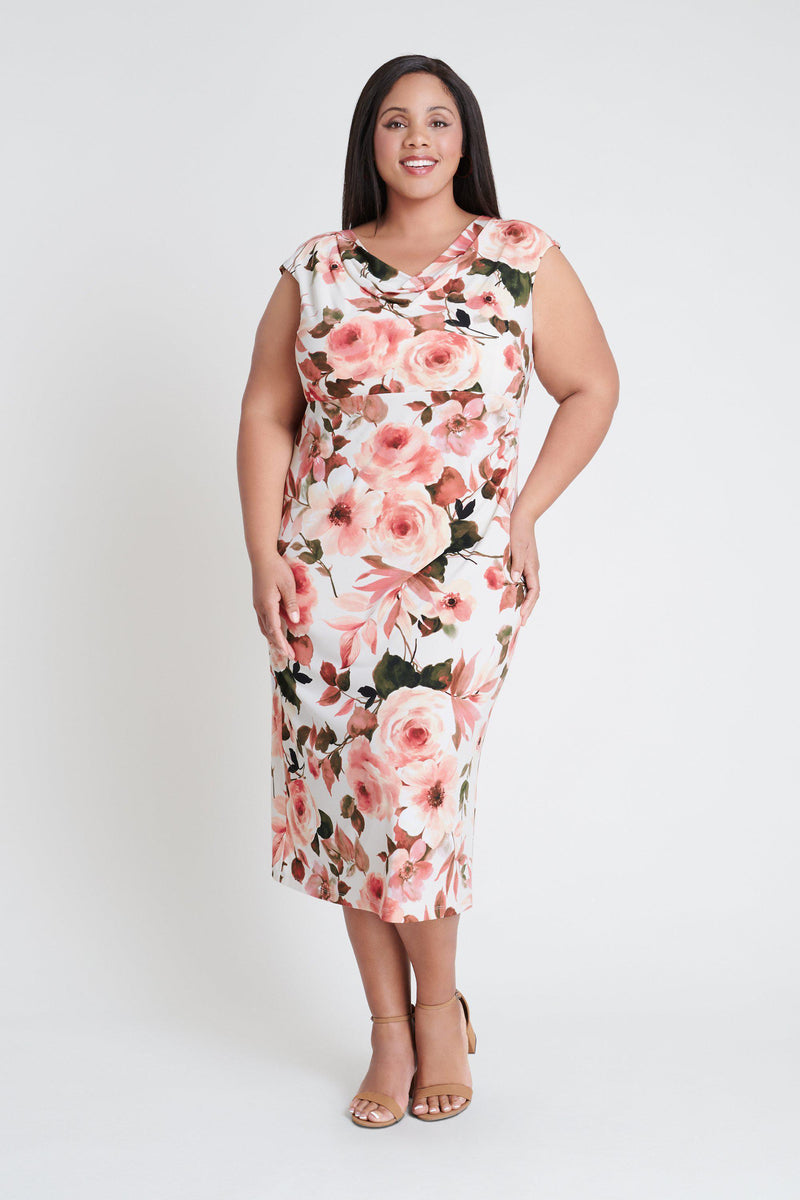 Woman posing wearing Coral Tonya Coral Floral Print Midi Dress from Connected Apparel