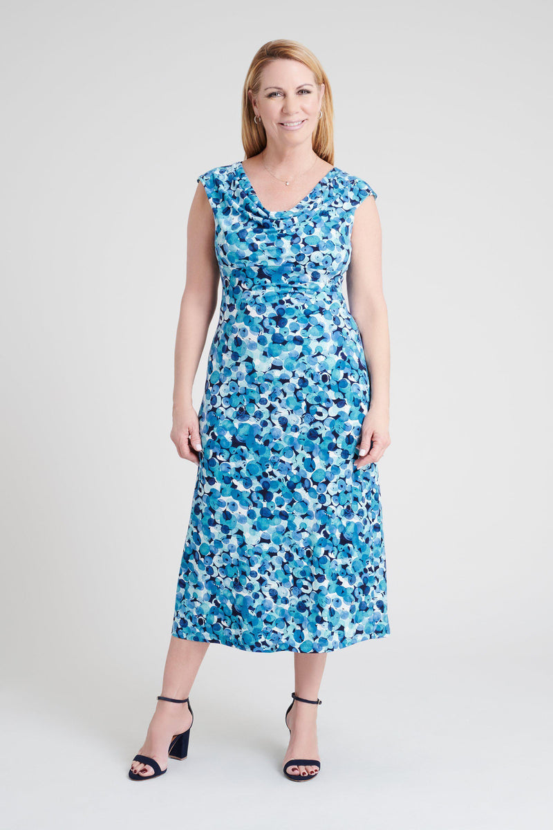 woman-wearing-connected-apparel-Tonya Dusty Turquoise Abstract Print Dress-posing-on-plain-background