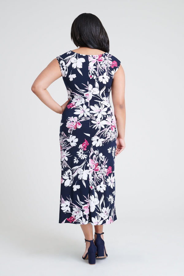 woman-wearing-connected-apparel-Tonya Navy Floral Print Dress-posing-on-plain-background
