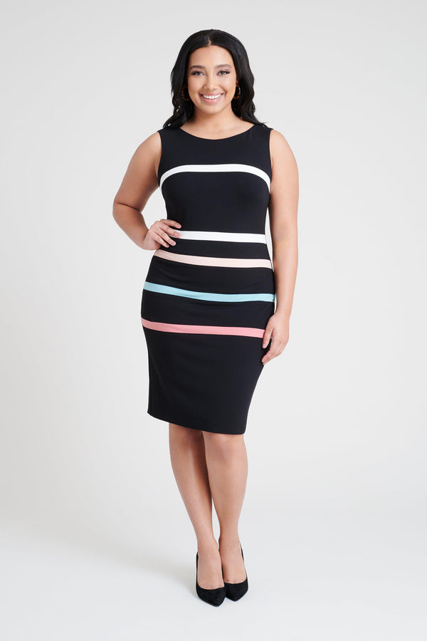 woman-wearing-connected-apparel-Winnie Striped Dress [PRE-ORDER]-posing-on-plain-background