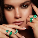 Maria Jose Jewelry Emerald Solitaire Ring on Model Wearing a Collection of Emerald Rings