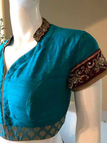 Teal silk blouse