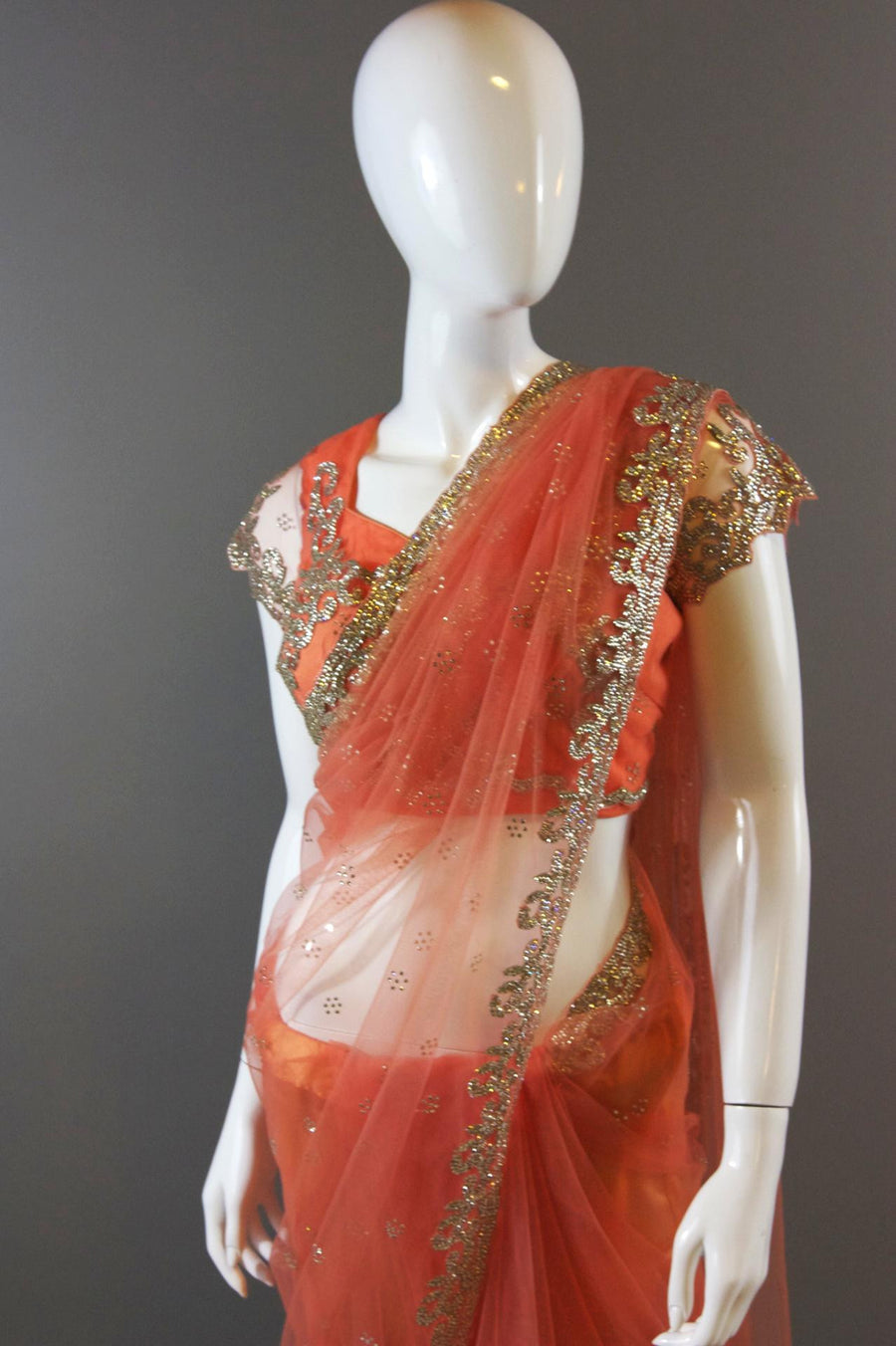 Peach Crystal Border Net Saree