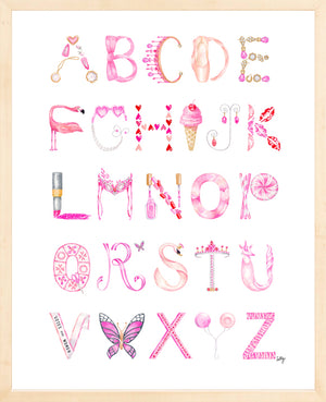 Watercolor Alphabet print in blonde wood frame, featuring letters in shades of pink representing different objects inspired by the 21st-Century Girly-Girl