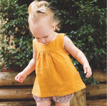 Spark Sisters girl wearing linen tank mustard blue green white pink vintage classic toddler clothing boho