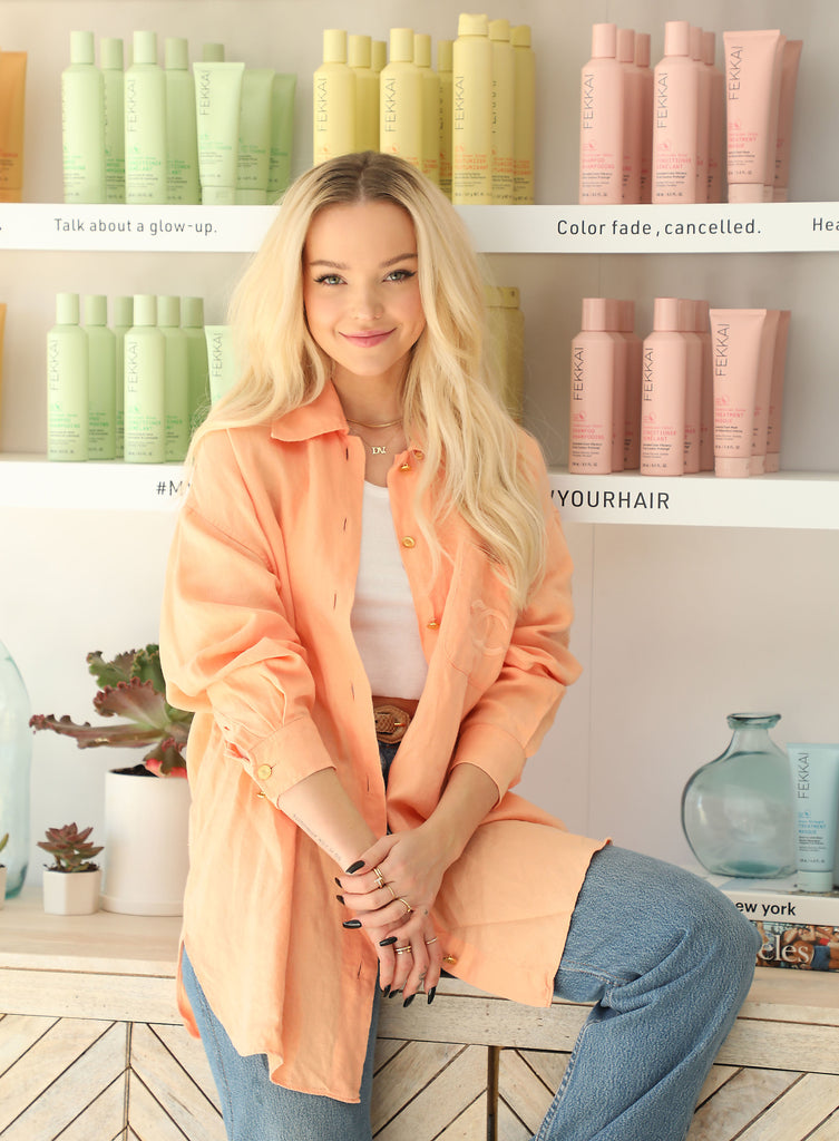 Star Dove Cameron at the FEKKAI Takes the Santa Monica Pier event in Los Angeles, posing in the FEKKAI salon pop-up in front of the brand's colorful clean products
