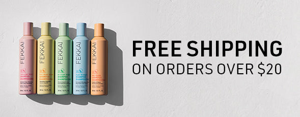 Frederic Fekkai free shipping banner image with shampoo bottles in front of beige background