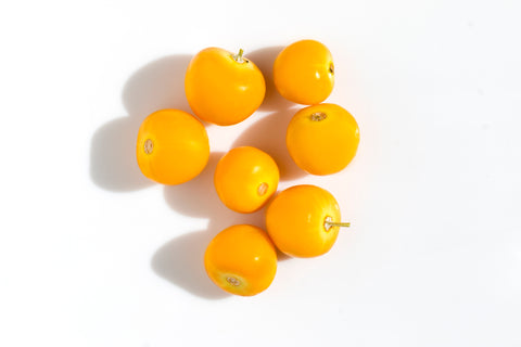 Mirabelle plums on a white background