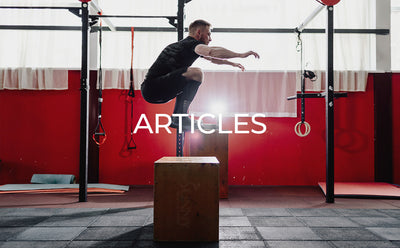man doing plyometric box exercise