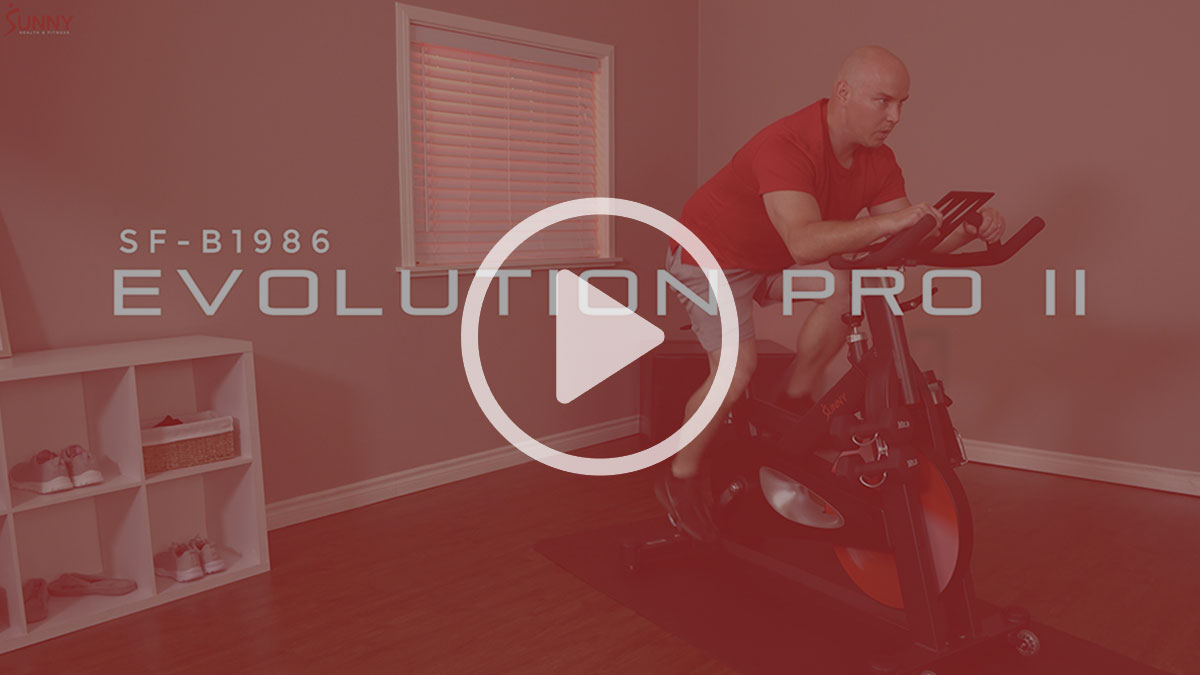 man exercising on Evolution Pro II indoor cycle bike