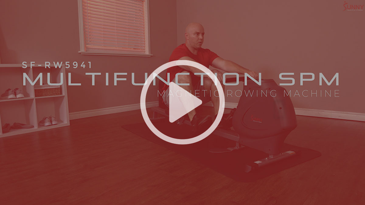 man exercising on rowing machine