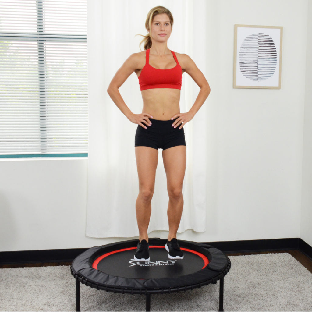 woman standing on trampoline