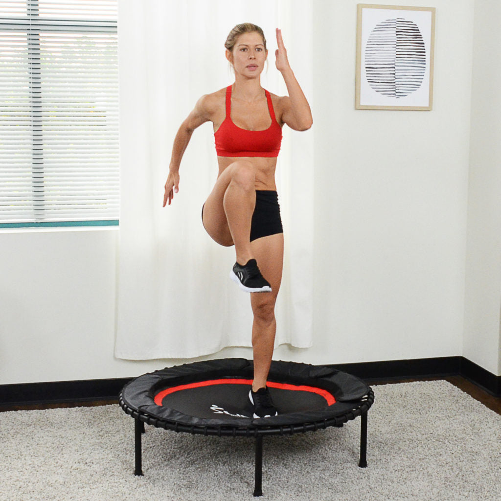 woman doing high knee exercise on trampoline