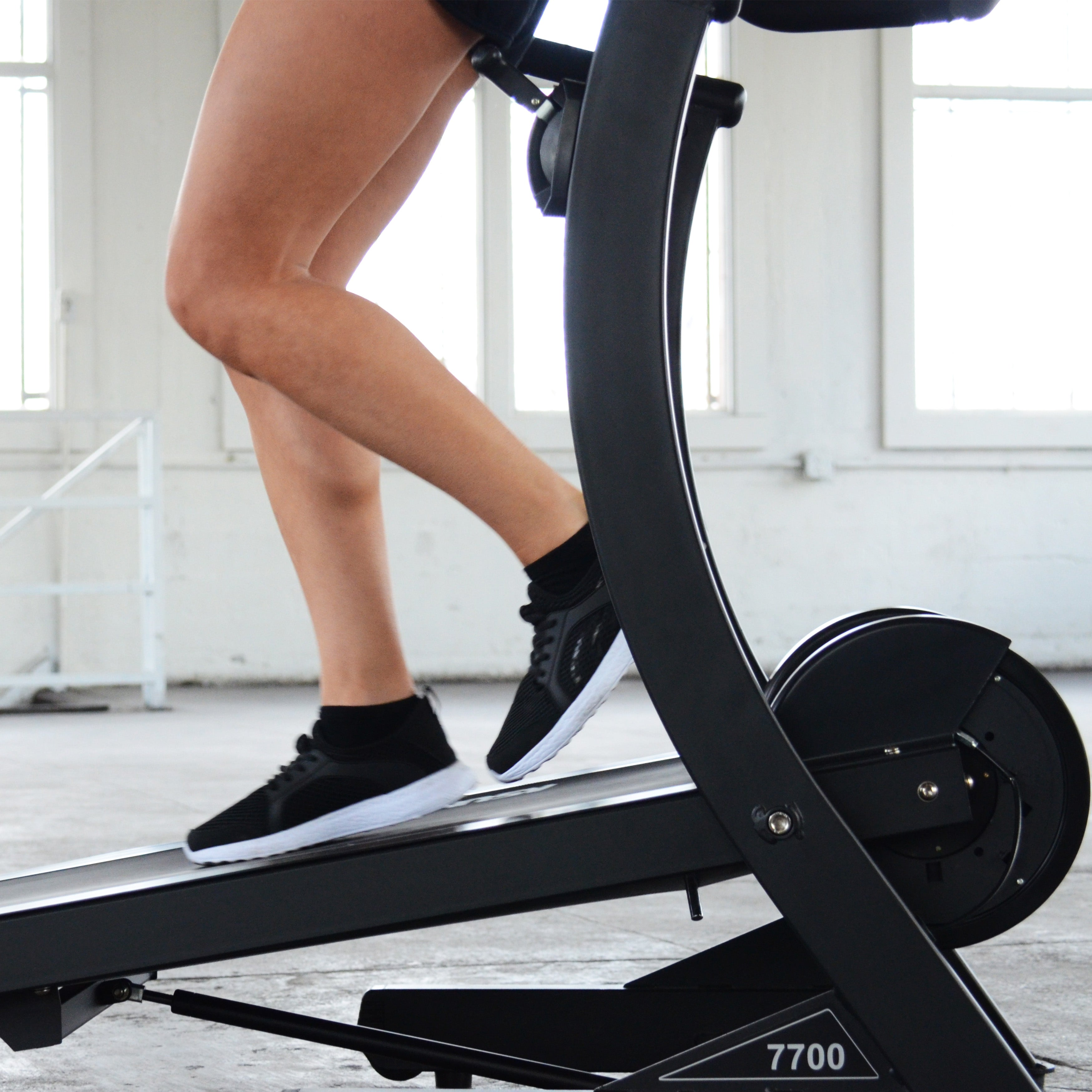 legs walking backwards on treadmill
