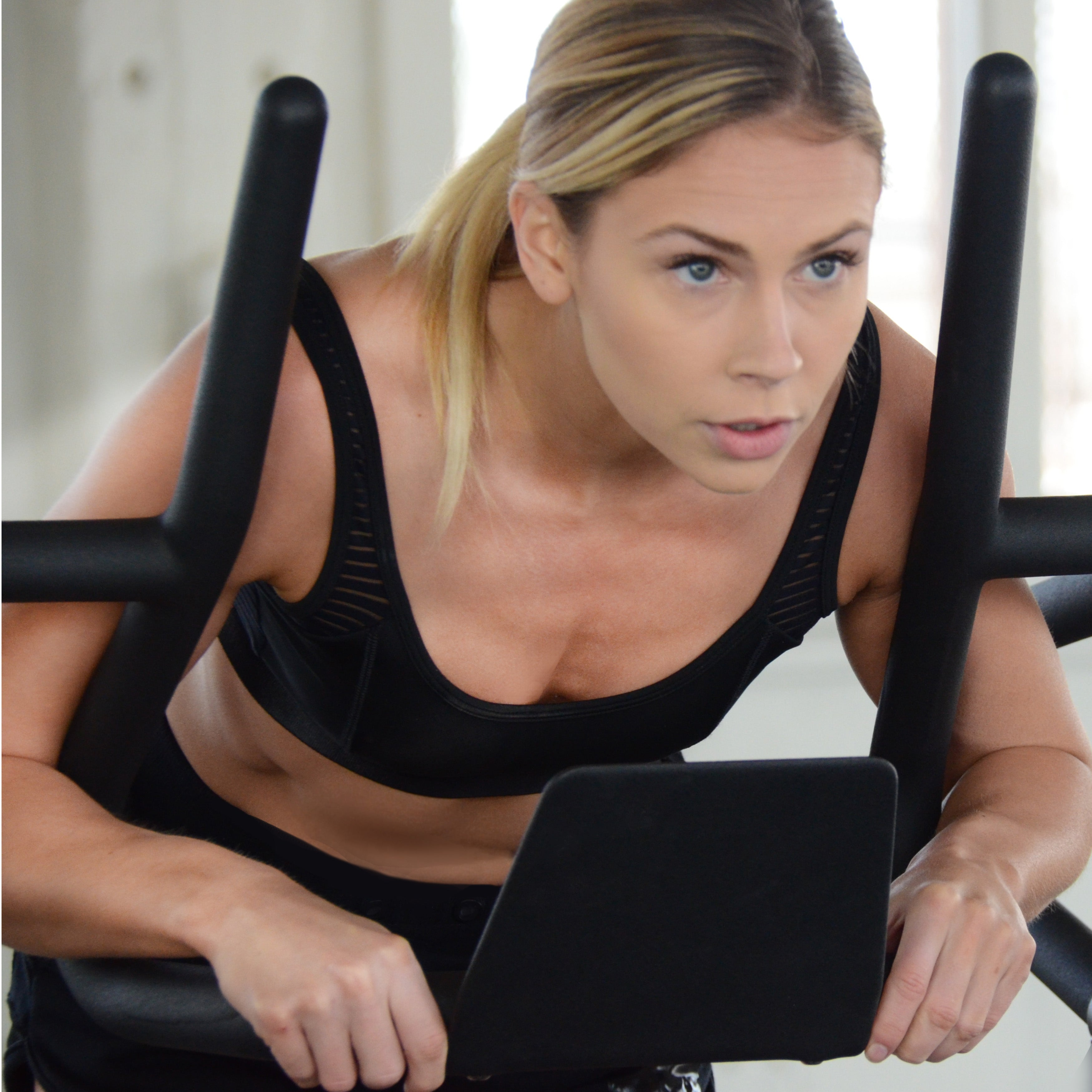woman upper body leaning on treadmill