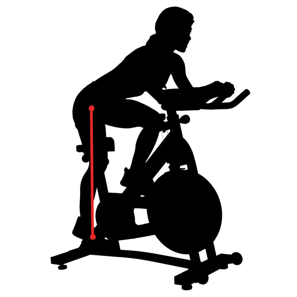 silhouette of woman sitting on indoor cycle bike with red line indicating inseam