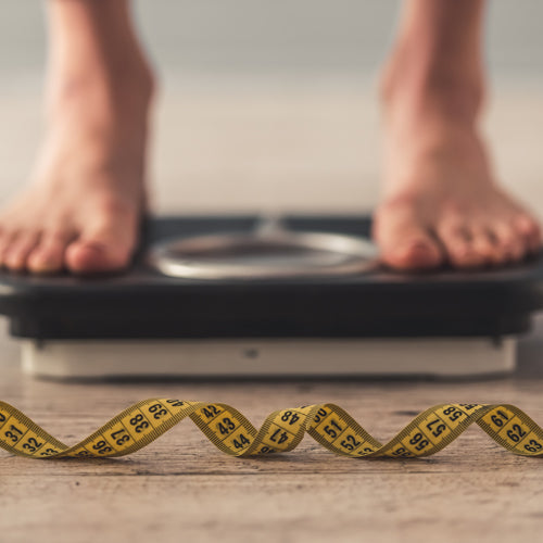 a person is on a weight scale