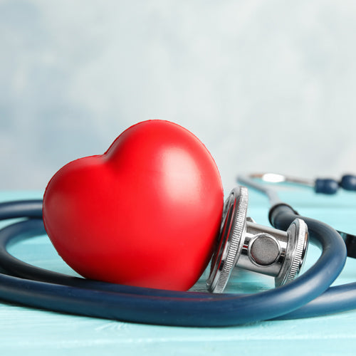 a red heart surround by stethoscope