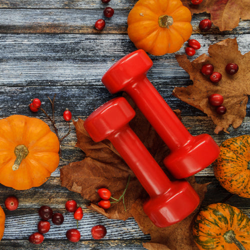 a pair of dumbbells with pumpkins