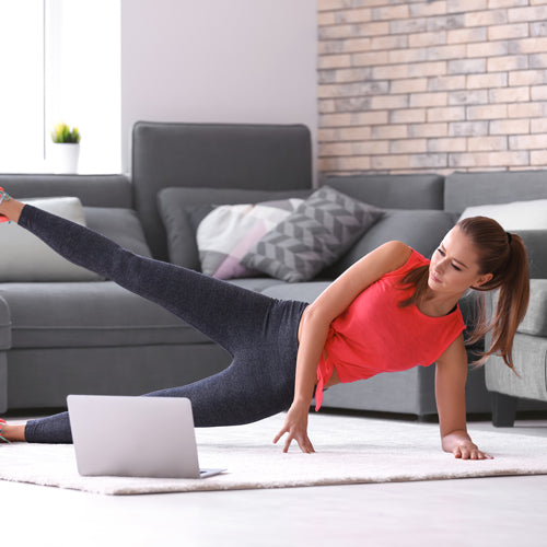 a woman is exercising in living room