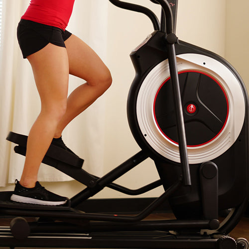 a person is pedaling elliptical machine