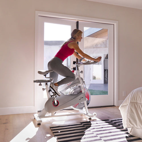 a woman is cycling at home