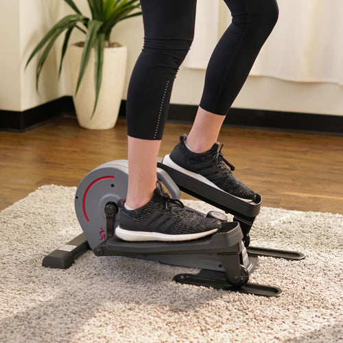 a person is pedaling standup elliptical