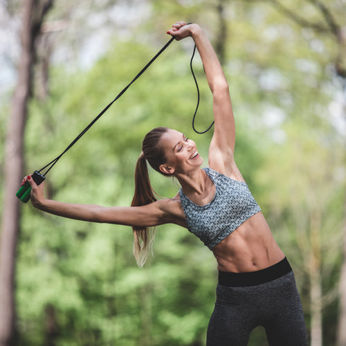 a lady is stretching with a jump rope