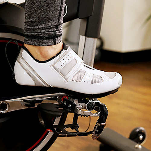 a white cycling shoe on pedal