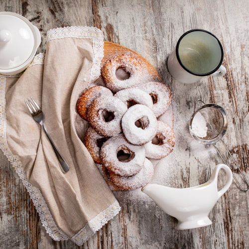 frosted doughnuts with glass bottles