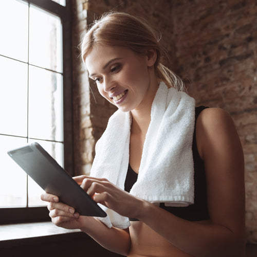 a person is watching tablet after working out