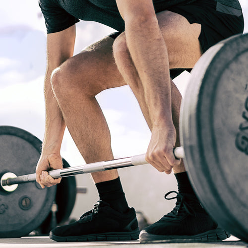 a man is lifting barbell