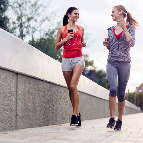 two women are jogging