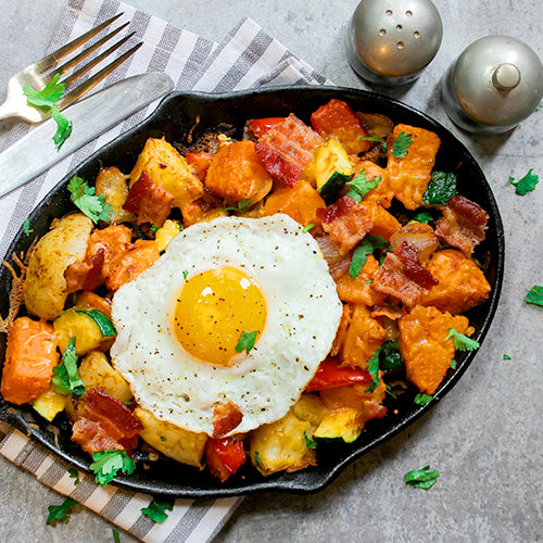 healthy meal prep dishes egg potatoes on skillet