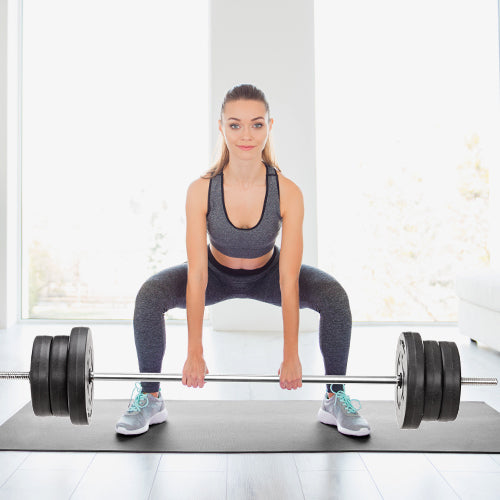 woman is holding barbell