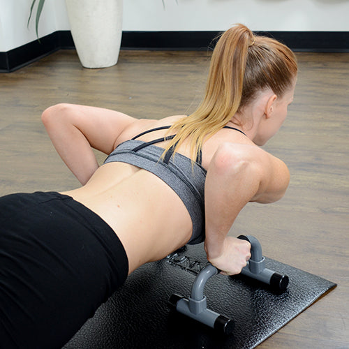 a woman is doing pushup