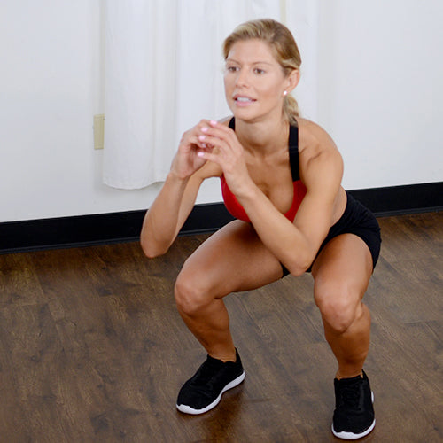 a woman is squatting
