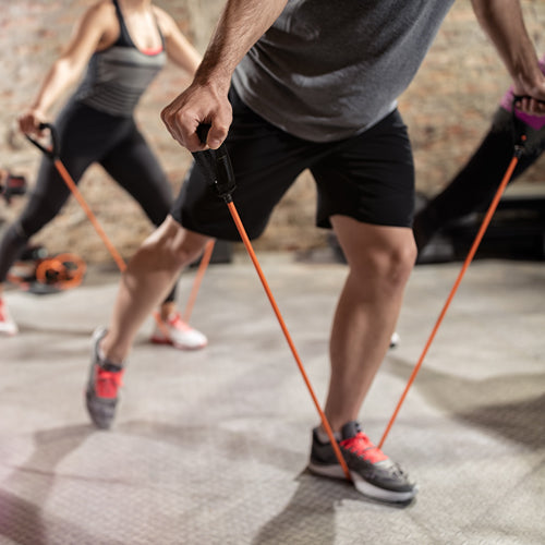 a man is using resistance band