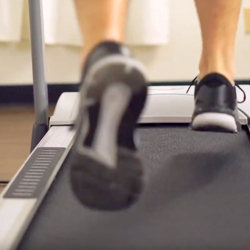 a man is running on treadmill