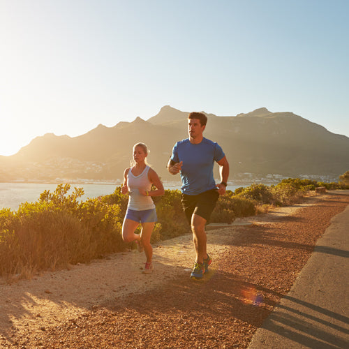 two people are running outdoors